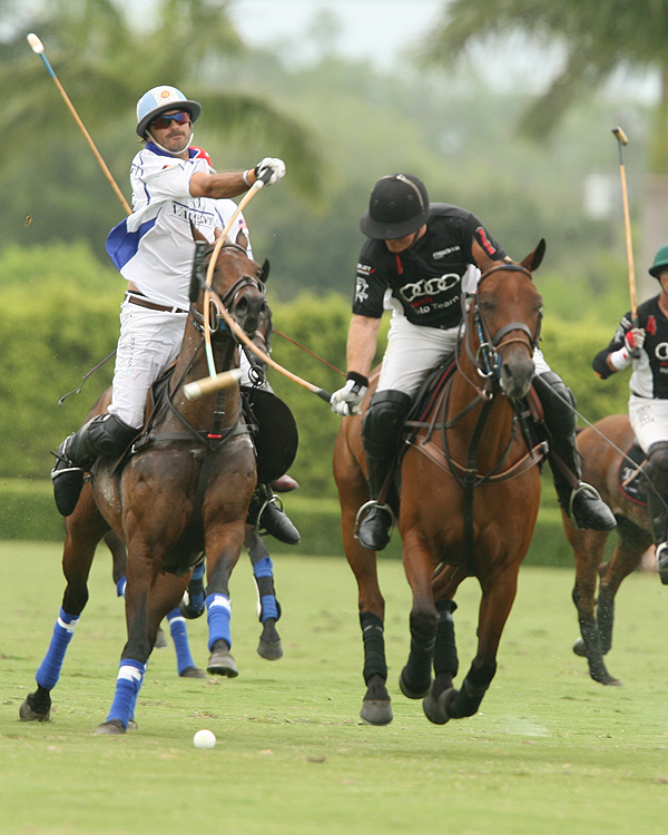 Valiente 10-goaler Adolfo Cambiaso hooks Audi team captain Marc Ganzi who re-injured his broken thumb on his mallet hand and was forced to leave the game in the fifth chukker